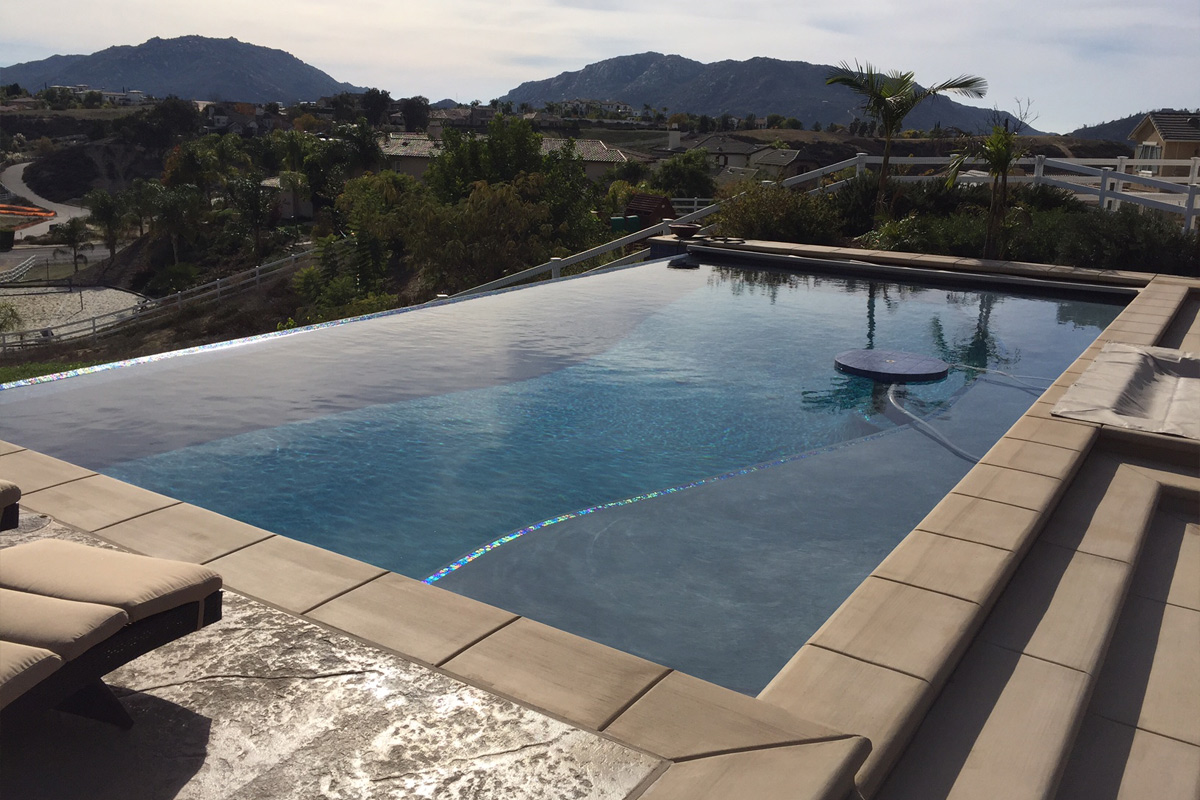 Infinity pools and spas sunset outdoor creations for Infinity swimming pools pictures